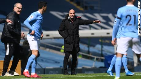 Guardiola gives his team instructions during the Premier League match between Manchester City and Leeds United.