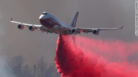ANGWIN, CALIFORNIA - SEPTEMBER 27: The Global Supertanker drops retardant ahead of the Glass on September 27, 2020 in Angwin, California. The fast moving Glass fire has burned over 1,000 acres and has destroyed homes. Much of Northern California is under a red flag warning for high fire danger through Monday evening. (Photo by Justin Sullivan/Getty Images)