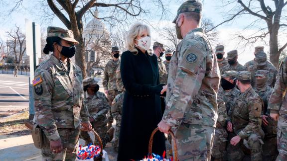 Biden greets members of the National Guard with chocolate chip cookies outside the US Capitol in January.