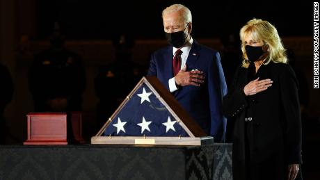 The first lady and President Joe Biden pay their respects to US Capitol officer Brian D. Sicknick as he lies in honor in the US Capitol in February.