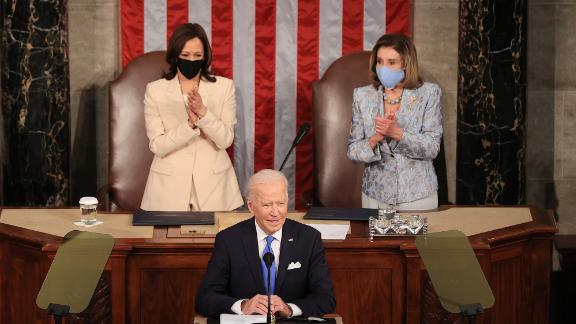 WASHINGTON, DC - APRIL 28: U.S. President Joe Biden addresses a joint session of congress as Vice President Kamala Harris (L) and Speaker of the House U.S. Rep. Nancy Pelosi (D-CA) (R) look on in the House chamber of the U.S. Capitol April 28, 2021 in Washington, DC. On the eve of his 100th day in office, Biden spoke about his plan to revive America's economy and health as it continues to recover from a devastating pandemic. He delivered his speech before 200 invited lawmakers and other government officials instead of the normal 1600 guests because of the ongoing COVID-19 pandemic. (Photo by Chip Somodevilla/Getty Images)