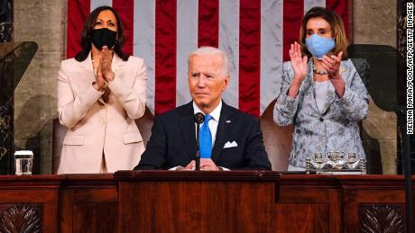 US Vice President Kamala Harris (L) and Speaker of the House of Representatives Nancy Pelos (R) applaud as US President Joe Biden addresses a joint session of Congress at the US Capitol in Washington, DC, on April 28, 2021.