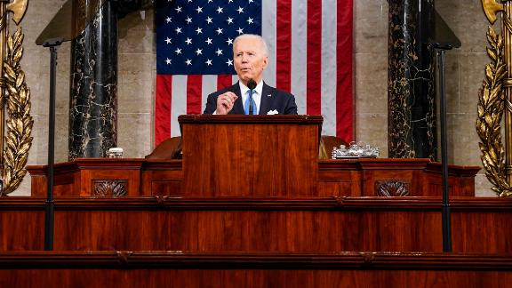 U.S. President Joe Biden addresses a joint session of Congress as Vice President Kamala Harris (L) and Speaker of the House U.S. Rep. Nancy Pelosi (D-CA) (R) look on in the House chamber of the U.S. Capitol April 28, 2021 in Washington, DC. On the eve of his 100th day in office, Biden spoke about his plan to revive America's economy and health as it continues to recover from a devastating pandemic. He delivered his speech before 200 invited lawmakers and other government officials instead of the normal 1600 guests because of the ongoing COVID-19 pandemic.