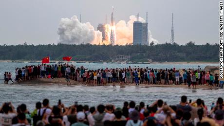 People watch as the Long March-5B carrier rocket blasted off from the Wenchang Space Launch Center in Hainan Province, carrying the space stationcore module on Tuesday.   - 210429103434 02 china space station launch 0429 restricted large 169 - China space station: Successful launch of Tianhe, the first module of planned space station