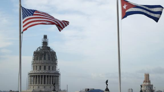 HAVANA, CUBA - MARCH 20:  United States and Cuban flags fly side-by-side on the roof of the Iberostar Hotel Parque Central near El Capitolio (background) in the historic Old Havana neighborhood March 20, 2016 in Havana, Cuba. President Barack Obama is scheduled to arrive in Cuba Sunday afternoon, the first time a sitting U.S. president has visited the island nation in nearly 90 years.  (Photo by Chip Somodevilla/Getty Images)