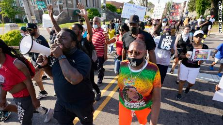 Demonstrators marched in the streets to protest the shooting of Little Brown in Elizabeth City.