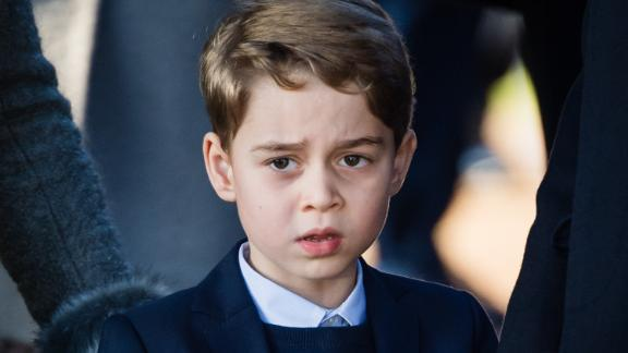 Prince George, the eldest son of Prince William and Catherine, the Duchess of Cambridge, attends a Christmas Day church service in 2019. George is third in line to the British throne, behind his father and his grandfather, Prince Charles.