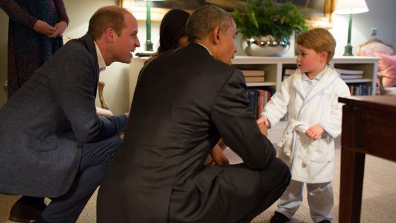 US President Barack Obama talks to Prince George while visiting Kensington Palace in 2016.