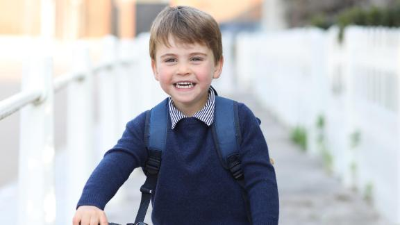 Prince Louis, William and Kate's youngest son, rides his bicycle before leaving for his first day of nursery school in April 2021. Louis is fifth in line to the throne.