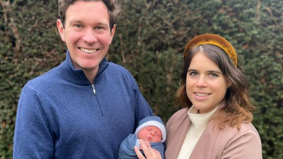 Princess Eugenie and her husband, Jack Brooksbank, hold their newborn son, August, in February 2021. August is 11th in line to the throne, behind his mother, his aunt Princess Beatrice and his grandfather, Prince Andrew.