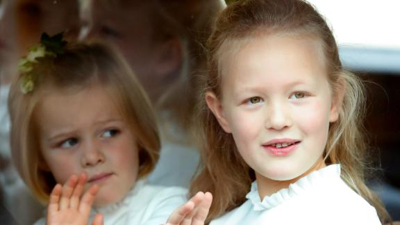 Cousins Mia Tindall, left, and Savannah Phillips attend the wedding of Princess Eugenie in 2018. Mia and Savannah are two grandchildren of the Queen's only daughter, Princess Anne. Mia is one of three children born to Mike and Zara Tindall. Savannah is one of two children born to Peter and Autumn Phillips.
