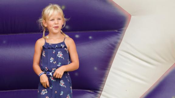 Isla Phillips, Savannah's sister, plays on an inflatable slide during a festival in 2018.