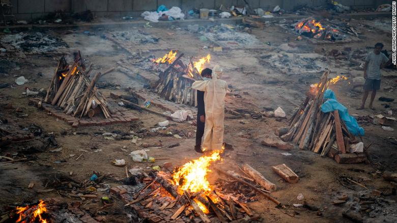As India's crematoriums overflow with Covid victims, pyres burn through the night