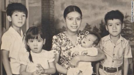 Long Trieu, Nina Trieu Tarnay, Tina Bui Trieu holding Quang Trieu, Mason Phuoc Trieu in 1976 in a photo taken while the author's father was imprisoned.