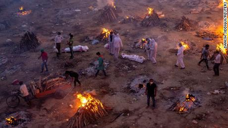 People wait to cremate the bodies at a crematorium in New Delhi on April 23.