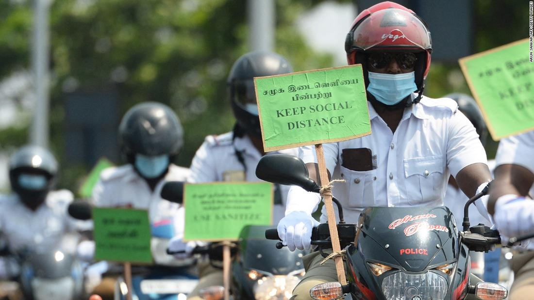 Police personnel hold placards on their motorbikes during a Covid-19 awareness rally in Chennai on Thursday, April 29.