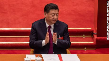 China's President Xi Jinping applauds during the closing session of the National Peoples Congress (NPC) at the Great Hall of the People in Beijing on March 11, 2021.