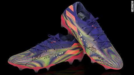 Lionel Messi: Barcelona star's pair of football boots auctioned for $ 173,000