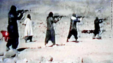 A video grab dated June 19, 2001 shows al Qaeda members  training.