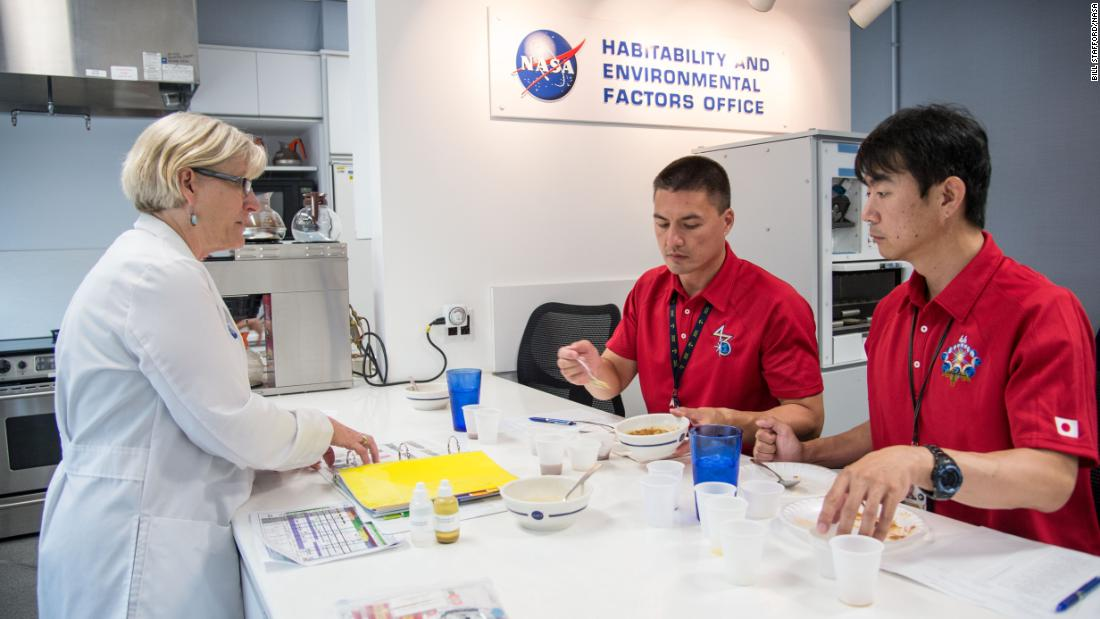 NASA astronaut Kjell Lindgren (center) and Japan Aerospace Exploration Agency astronaut Kimiya Yui (right), both Expedition 44/45 flight engineers, participate in a food tasting at NASA's Johnson Space Center in Houston, July 10, 2014.