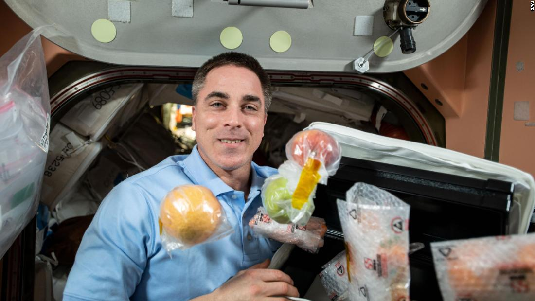 NASA astronaut and Expedition 63 Commander Chris Cassidy unpacks fresh fruit and other food items shipped aboard the Northrop Grumman Cygnus space freighter to the International Space Station, October 5, 2020.