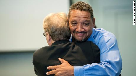 In this Wednesday, Aug. 31, 2016 file photo, Darryl Howard hugs attorney Barry Scheck after a judge threw out a double-murder conviction against him during a hearing at the Durham County Courthouse, in Durham, N.C.  North Carolina Gov. Roy Cooper granted a pardon of innocence Friday, April 30, 2021 to Darryl Anthony Howard, a man imprisoned for two decades before his two murder convictions were vacated more than four years ago by a trial judge.