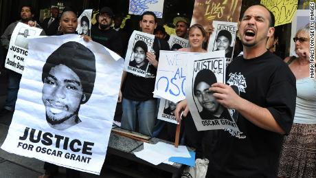 Aidge Patterson of the LA Coalition for Justice for Oscar Grant leads a protest rally in 2010. (MARK RALSTON/AFP via Getty Images)