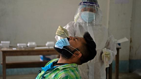 A health worker administers a Covid-19 test in Siliguri on April 30.