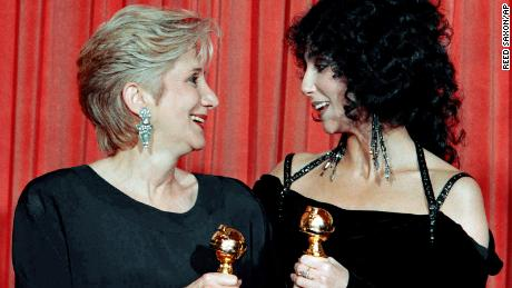 "Olympia Dukakis and Cher hold the Golden Globes they won in January 1988 for their performances in ""Moonstruck."" Both would go on to win Academy Awards later that year."
