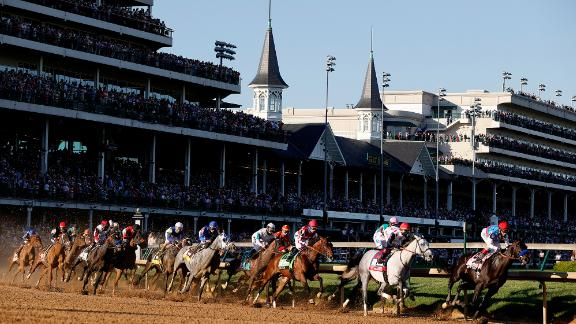 LOUISVILLE, KENTUCKY - MAY 01: Medina Spirit #8, ridden by jockey John Velazquez, leads the field around the first during the 147th running of the Kentucky Derby at Churchill Downs on May 01, 2021 in Louisville, Kentucky. (Photo by Sarah Stier/Getty Images)