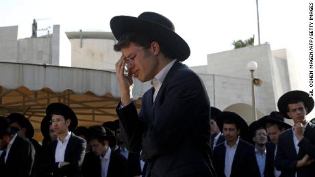 Ultra-Orthodox Jewish mourners attend the funeral of a victim of the stampede at Segula cemetery in Petah Tikva on April 30, 2021.