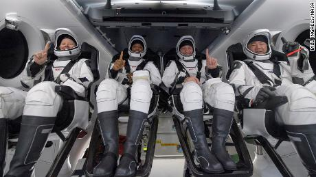 NASA astronauts Shannon Walker, left, Victor Glover, Mike Hopkins, and Japan Aerospace Exploration Agency (JAXA) astronaut Soichi Noguchi, right are seen shortly after landing