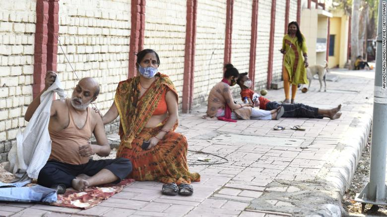 Covid-19 patients wait outside Sardar Patel Covid Care Centre, in New Delhi, on April 25.