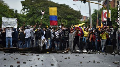 Demonstrators shout towards riot police officers during clashes in Cali, Colombia, on April 30, 2021.