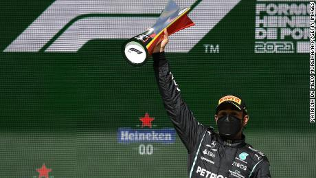 Hamilton celebrates on the podium after winning the Portuguese Grand Prix.