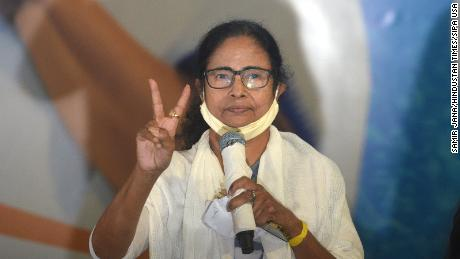 West Bengal Chief Minister Mamata Banerjee shows the victory sign after the announcement of state election results in Kolkata on May 2.