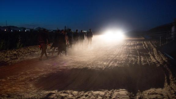 Central American asylum seekers are detained by the the U.S. Border Patrol after they crossed into the  United States from Mexico on April 29, 2021 near Yuma, Arizona.