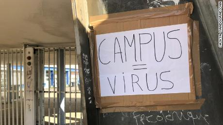 "A handwritten placard reading ""Campus = Virus"" at Eugene Delacroix high school."