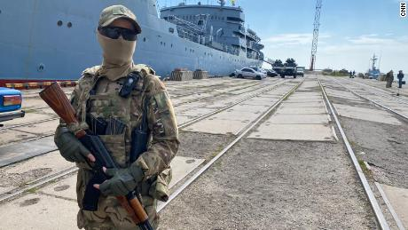 A Ukrainian guard stands in the port of Maripol.