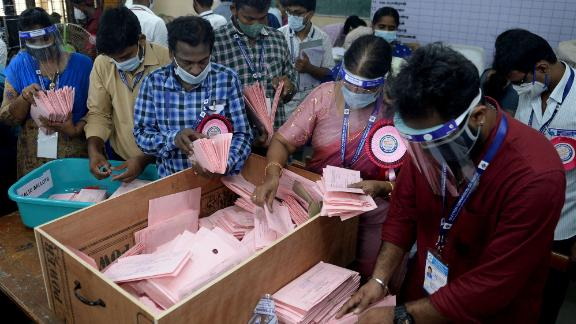 Officials in Chennai prepare to open postal ballots for state elections, which have taken place during this second wave of Covid-19.
