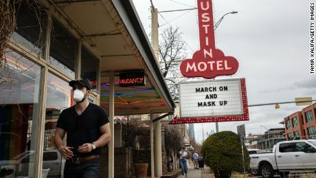 The Austin Motel displays a message on its marquee encouraging people to wear masks.
