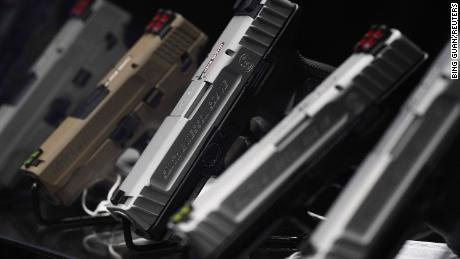 Asian Americans are buying guns in the wake of recent attacks, but community leaders say that's not the way to prevent hate crimes