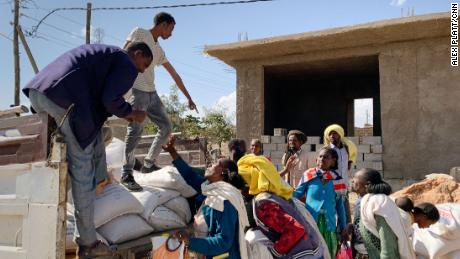 USAID distributes supplies in Hawzen, central Tigray, where residents hadn't received aid for two months.