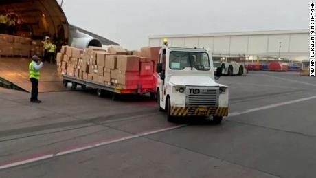 Foreign aid supplies being unloaded from planes at the airport in New Delhi, India, on April 29.