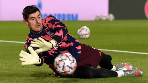 MADRID, SPAIN - DECEMBER 09: Thibaut Courtois of Real Madrid warms up prior to the UEFA Champions League Group B stage match between Real Madrid and Borussia Moenchengladbach at Estadio Alfredo di Stefano on December 09, 2020 in Madrid, Spain. Sporting stadiums around Spain remain under strict restrictions due to the Coronavirus Pandemic as Government social distancing laws prohibit fans inside venues resulting in games being played behind closed doors. (Photo by Denis Doyle/Getty Images)