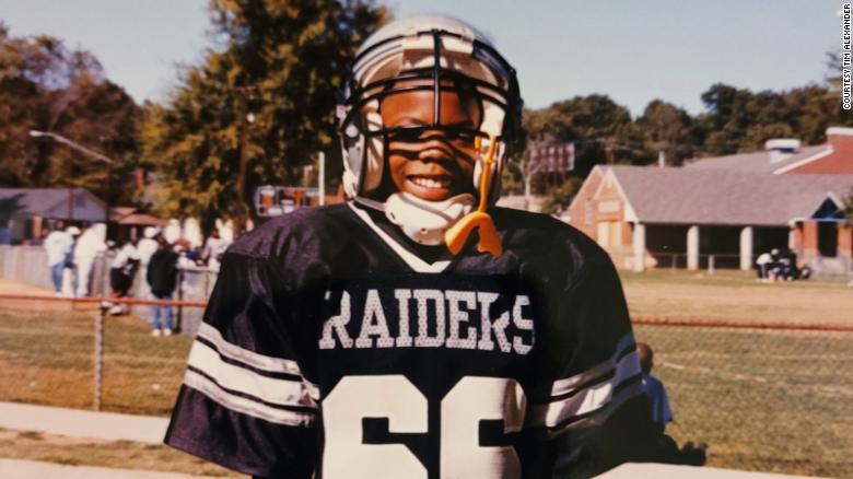 Timothy Alexander, age 7, playing little league football in Birmingham, Alabama.