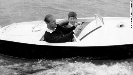The Prince of Wales with his father, the Duke of Edinburgh during a motorboat race up the river Medina at Cowes, Isle of Wight.   (Photo by PA Images via Getty Images)