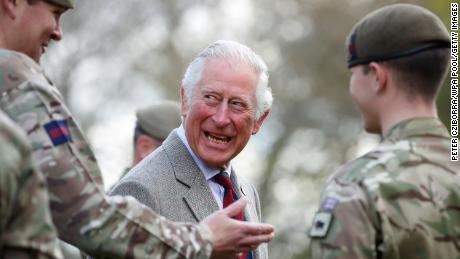 Prince Charles shares a joke with soldiers of the Welsh Guards during a visit to Combermere Barracks on May 5 in Windsor, England.