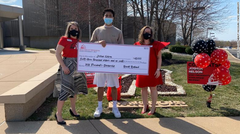 18-year-old Joshua Nelson standing with Katie Krodinger and Lenell Hahn, shows off the scholarship given to him by Southeast Missouri State University.