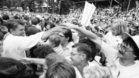 """Republican presidential candidate Ronald Reagan moves through a crowd shaking hands at the Neshoba County Fair in Philadelphia, Mississippi on Sunday, August 3, 1980. The """"Welfare Queen"""" story was part of Reagan's campaign speeches four years earlier."""